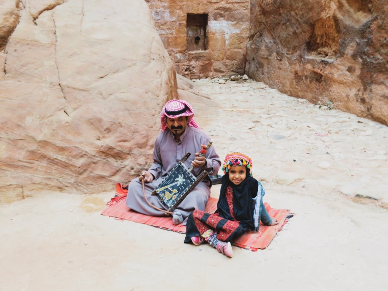 father and daughter musician at petra, jordan