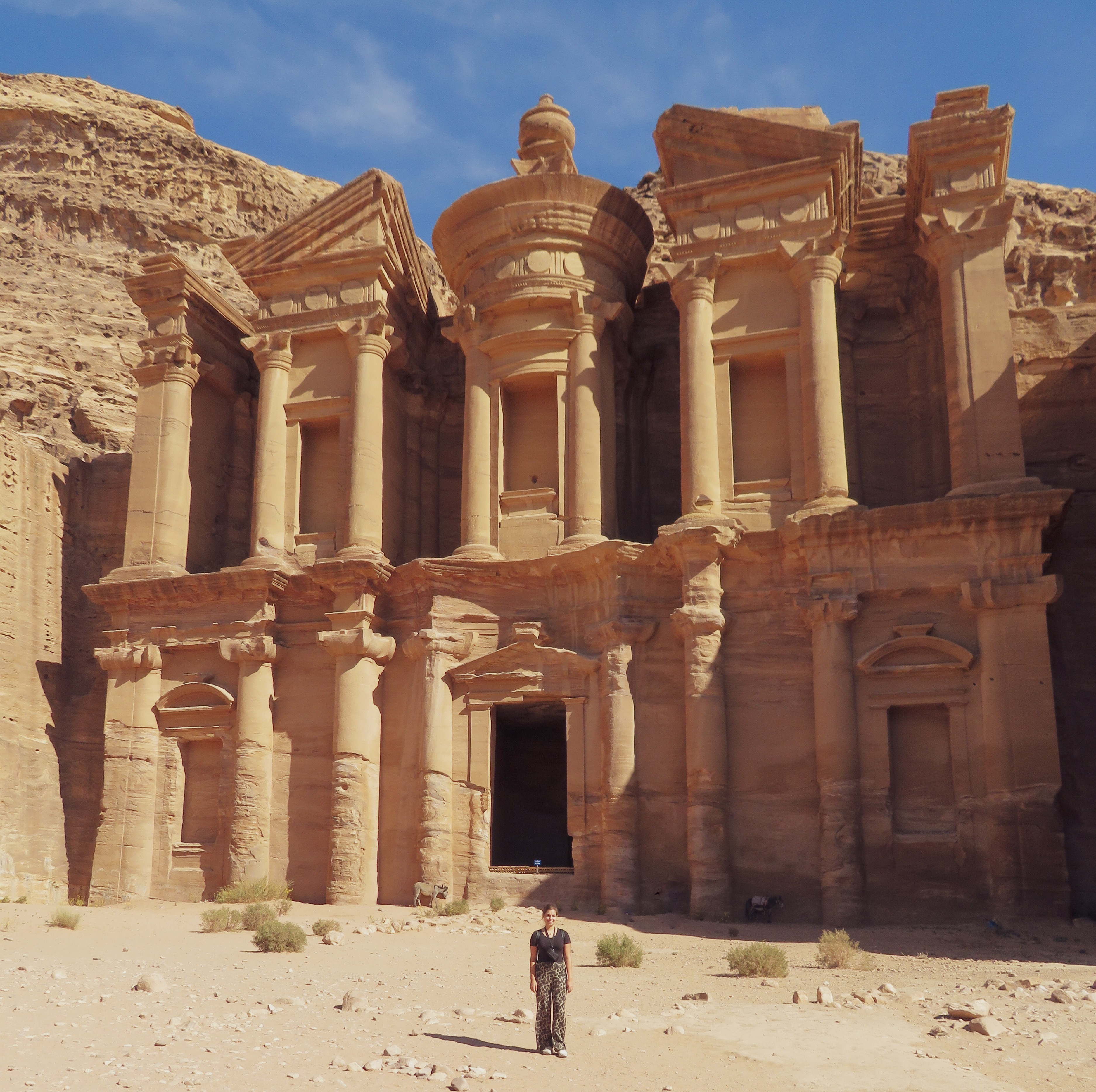 travel blogger at the monastery at Petra, Jordan