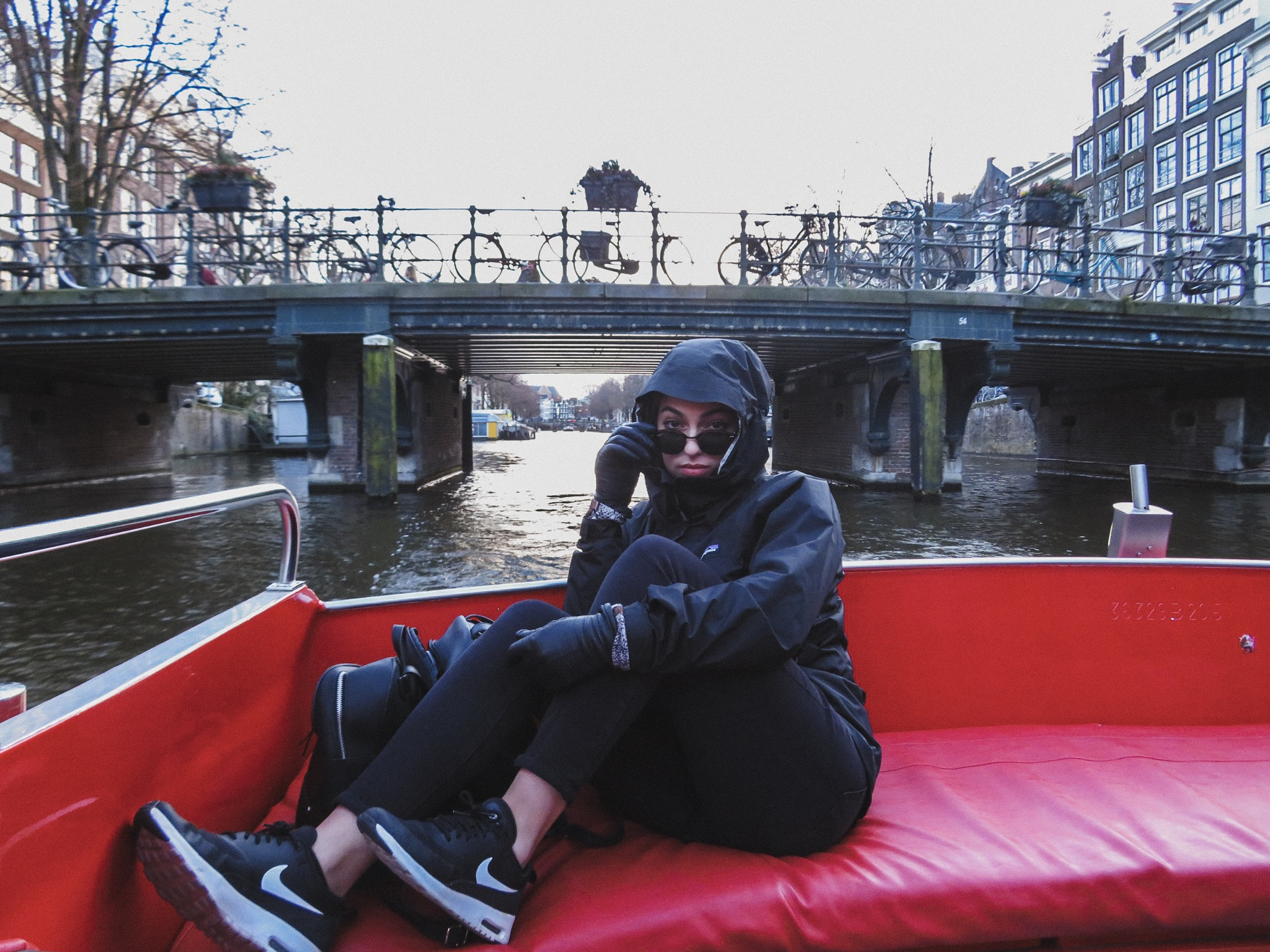 Travel blogger on Amsterdam Canal.